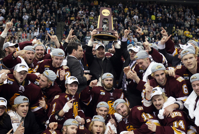 ST. PAUL, MN - APRIL 09:  :  :  :  The Minnesota Duluth Bulldogs celebrate with the trophy after they defeated the Michigan Wolverines after the championship game of the 2011 NCAA Men's Frozen Four on April 9, 2011 at the Xcel Energy Center in St. Paul, M