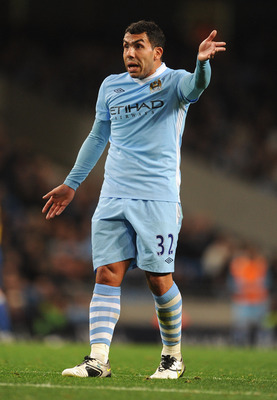 MANCHESTER, ENGLAND - SEPTEMBER 21: Carlos Tevez of Manchester City gestures during the Carling Cup Third Round match between Manchester City and Birmingham City at the Etihad Stadium on September 21, 2011 in Manchester, England.  (Photo by Michael Regan/