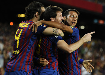 BARCELONA, SPAIN - SEPTEMBER 17:  Lionel Messi of FC Barcelona (C) celebrates with his teammate Cesc Fabregas (L) and Thiago Alcantara after scoring his first team's goalduring the La Liga soccer match between FC Barcelona and CA Osasuna at Camp Nou Stadi