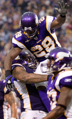 MINNEAPOLIS, MN - SEPTEMBER 18: Phil Loadholt #71 and Adrian Peterson #28 of the Minnesota Vikings celebrate a touchdown in the second quarter against the Tampa Bay Buccaneers on September 18, 2011 at Hubert H. Humphrey Metrodome in Minneapolis, Minnesota