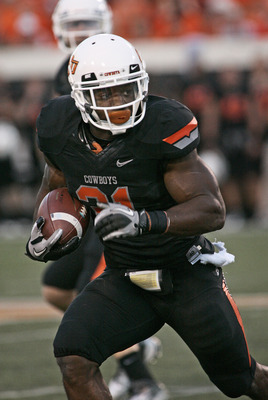 STILLWATER, OK - SEPTEMBER 8: Running back Jeremy Smith #31of the Oklahoma State Cowboys rushes up field during the first half against the Arizona Wildcats on September 8, 2011 at Boone Pickens Stadium in Stillwater, Oklahoma.  Oklahoma State defeated Ari