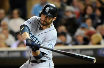 MINNEAPOLIS, MN - SEPTEMBER 21: Dustin Ackley #13 of the Seattle Mariners hits an RBI double against the Minnesota Twins in the sixth inning on September 21, 2011 at Target Field in Minneapolis, Minnesota. (Photo by Hannah Foslien/Getty Images)