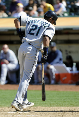 OAKLAND, CA - SEPTEMBER 04: Franklin Gutierrez #21 of the Seattle Mariners swings at a pitch and hurts himself against the Oakland Athletics in the eight inning during an MLB baseball game at O.co Coliseum on September 4, 2011 in Oakland, California. The