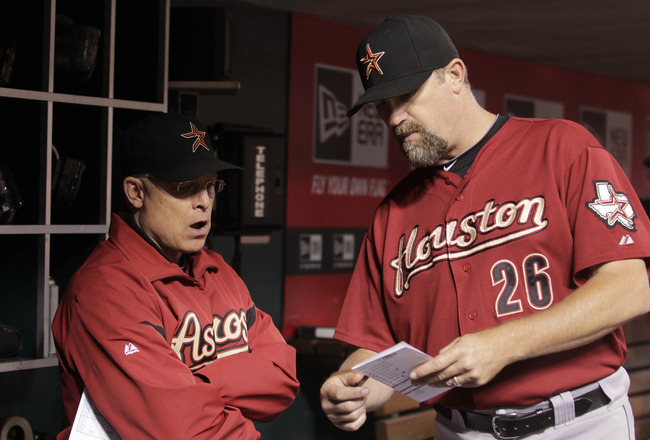 CINCINNATI, OH - SEPTEMBER 20: Brad Mills #2 manager of the Houston Astros talks with Doug Brocail #26 of the Houston Astros during game action against the Cincinnati Reds at Great American Ball Park on September 20, 2011 in Cincinnati, Ohio.  (Photo by J