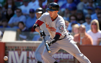 CHICAGO, IL - SEPTEMBER 17:   Jordan Schafer #1 of  the Houston Astros bunts against the Chicago Cubs at Wrigley Field on September 17, 2011 in Chicago, Illinois.  (Photo by Tasos Katopodis /Getty Images)