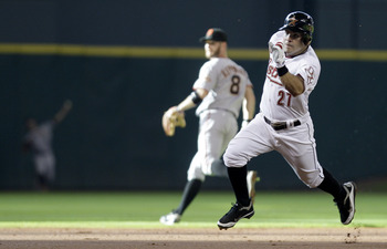 HOUSTON, TX- AUGUST 20: Second baseman Jose Altuve #27 of the Houston Astros rounds second base after he hit an inside the park home run against  the San Francisco Giants in the first inning on August 20, 2011 at Minute Maid Park in Houston, Texas.(Photo