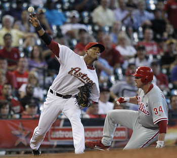 HOUSTON - SEPTEMBER 14:  Third baseman Jimmy Paredes #38 of the Houston Astros throws to first base after a force out of Roy Halladay #34 of the Philadelphia Phillies at Minute Maid Park on September 14, 2011 in Houston, Texas.  (Photo by Bob Levey/Getty