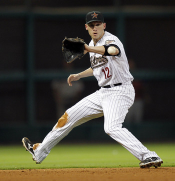 HOUSTON - SEPTEMBER 13:  Shortstop Clint Barmes #12 of the Houston Astros fields a ground ball off the bat of Michael Martinez of the Philadelphia Phillies in the sixth inning at Minute Maid Park on September 13, 2011 in Houston, Texas.  (Photo by Bob Lev