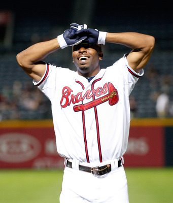 Bourn's triple tied the game in the 8th, but he couldn't do it again in the 12th.