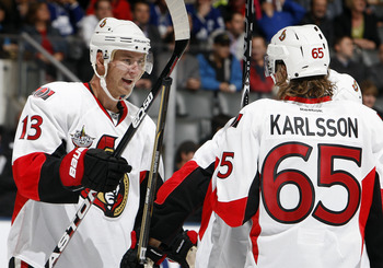 TORONTO, CANADA - SEPTEMBER 19: Peter Regin #13 and Erik Karlsson #65 of the Ottawa Senators celebrate goal against the Toronto Maple Leafs during preseason NHL action at the Air Canada Centre September 19, 2011 in Toronto, Ontario, Canada. (Photo by Abel