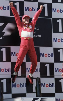 1 Jul 2001:  Michael Schumacher of Germany and Ferrari jumps for joy on the podium after winning the French Formula One Grand Prix at Magny Cours in France \ Mandatory Credit: Mark Thompson /Allsport