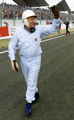 16 Jun 2001:  Sir Stirling Moss prepares to race in the race of legends before the Le Mans 24 Hour Race, La Sarthe, France.           + DIGITAL IMAGE +                                                                   Mandatory Credit: Mark Thompson/ALLSP