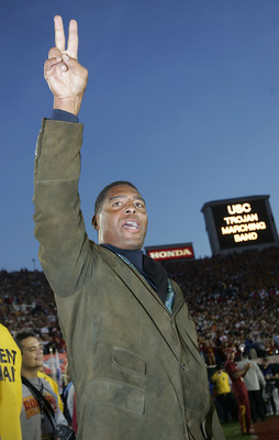 PASADENA, CA - JANUARY 04:  Former USC Trojans star Marcus Allen sings the team's fight song on the sidelines before the start of the BCS National Championship Rose Bowl Game against the Texas Longhorns on January 4, 2006 in Pasadena, California.  (Photo