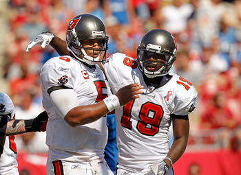 TAMPA, FL - SEPTEMBER 11:  Josh Freeman #5 and  Mike Williams #19 of the Tampa Bay Buccaneers celebrate after a touchdown during the season opener against the Detroit Lions at Raymond James Stadium on September 11, 2011 in Tampa, Florida.  (Photo by Mike