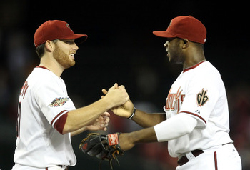 PHOENIX, AZ - SEPTEMBER 19:  Starting pitcher Ian Kennedy #31 of the Arizona Diamondbacks celebrates with Justin Upton #10 after defeating the Pittsburgh Pirates in the Major League Baseball game at Chase Field on September 19, 2011 in Phoenix, Arizona. T