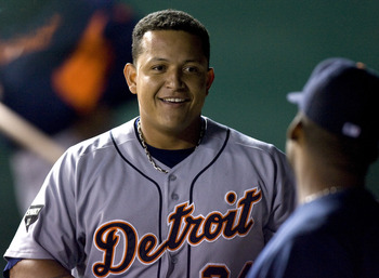 KANSAS CITY, MO - SEPTEMBER 21:   Miguel Cabrera #24 of the Detroit Tigers smiles as he walks through the dugout after hitting a RBI double in the eighth inning during a game against the Kansas City Royals at Kauffman Stadium on September 21, 2011 in Kans