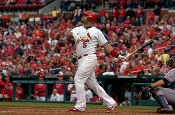 ST. LOUIS, MO - SEPTEMBER 22: Albert Pujols #5 of the St. Louis Cardinals hits a solo home run against the New York Mets at Busch Stadium on September 22, 2011 in St. Louis, Missouri.  (Photo by Jeff Curry/Getty Images)