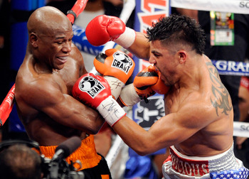 LAS VEGAS, NV - SEPTEMBER 17:  Floyd Mayweather Jr. (L) and Victor Ortiz battle in the fourth round of their WBC welterweight title fight at the MGM Grand Garden Arena September 17, 2011 in Las Vegas, Nevada. Mayweather knocked out Ortiz in the fourth rou