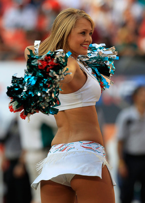 MIAMI GARDENS, FL - SEPTEMBER 18:  A Miami Dolphins cheerleader performs during a game against the Houston Texans  at Sun Life Stadium on September 18, 2011 in Miami Gardens, Florida.  (Photo by Sam Greenwood/Getty Images)