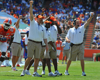 GAINESVILLE, FL - APRIL 9:  Defensive coordinator Dan Quinn (left);  and linebacker coach D. J. Durkin (right) of the Florida Gators direct play during the Orange and Blue spring football game April 9, 2011 Ben Hill Griffin Stadium at Gainesville, Florida