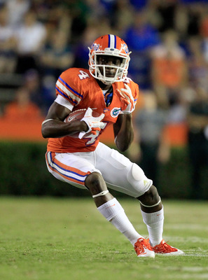 GAINESVILLE, FL - SEPTEMBER 03:  Andre Debose #4 of the University of Florida Gators runs for yardage during a game against the Florida Atlantic University Owls at Ben Hill Griffin Stadium on September 3, 2011 in Gainesville, Florida.  (Photo by Sam Green