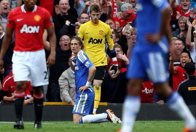 MANCHESTER, ENGLAND - SEPTEMBER 18:  Fernando Torres of Chelsea reacts after missing an open goal during the Barclays Premier League match between Manchester United and Chelsea at Old Trafford on September 18, 2011 in Manchester, England.  (Photo by Clive