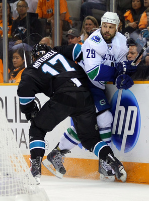 SAN JOSE, CA - MAY 20:  Torrey Mitchell #17 of the San Jose Sharks checks Aaron Rome #29 of the Vancouver Canucks in Game Three of the Western Conference Finals during the 2011 Stanley Cup Playoffs at HP Pavilion on May 20, 2011 in San Jose, California. T