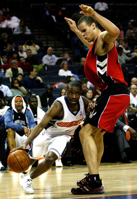 CHARLOTTE, NC - MARCH 02:  Kris Humphries #43 of the Toronto Raptors tries to stop Earl Boykins #11 of the Charlotte Bobcats during their game at Bobcats Arena on March 2, 2008 in Charlotte, North Carolina. NOTE TO USER: User expressly acknowledges and ag