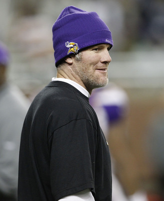 DETROIT, MI - DECEMBER 13:  Brett Favre #4 of the Minnesota Vikings walks on the field during pre-game warm ups and will not dress for the game against the New York Giants on December 13, 2010 in Detroit, Michigan.  (Photo by Leon Halip/Getty Images)