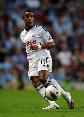 MANCHESTER, ENGLAND - AUGUST 15:  Scott Sinclair of Swansea City in action during the Barclays Premier League match between Manchester City and Swansea City at Etihad Stadium on August 15, 2011 in Manchester, England.  (Photo by Chris Brunskill/Getty Imag