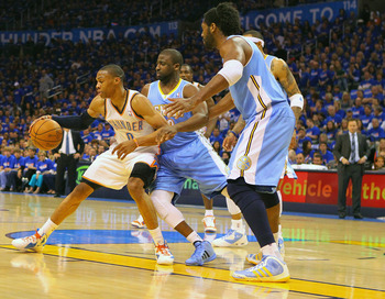 OKLAHOMA CITY, OK - APRIL 20: Russell Westbrook #0 of the Oklahoma City Thunder looks to get past Raymond Felton #20 of the Denver Nuggets in Game Two of the Western Conference Quarterfinals in the 2011 NBA Playoffs on April 20, 2011 at the Ford Center in
