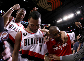 PORTLAND, OR - APRIL 23:  Brandon Roy #7 of the Portland Trail Blazers celebrates with teammates Marcus Camby #23 and Armon Johnson #1 after overcoming a 23 point deficit to defeat the of the Dallas Mavericks 84-82 in Game Four of the Western Conference Q