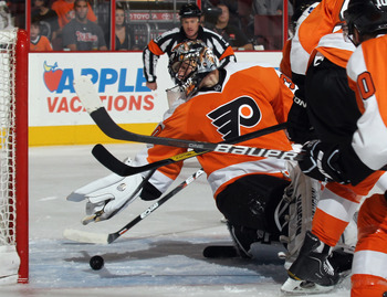 PHILADELPHIA, PA - SEPTEMBER 21: Ilya Bryzgalov #30 of the Philadelphia Flyers reaches back to make the first period save against the Toronto Maple Leafs at the Wells Fargo Center on September 21, 2011 in Philadelphia, Pennsylvania.  (Photo by Bruce Benne