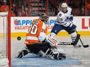 PHILADELPHIA, PA - SEPTEMBER 21: A shot by Tyler Bozak #42 of the Toronto Maple Leafs goes wide of Ilya Bryzgalov #30 of the Philadelphia Flyers at the Wells Fargo Center on September 21, 2011 in Philadelphia, Pennsylvania.  (Photo by Bruce Bennett/Getty