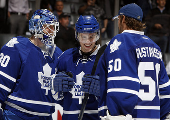 TORONTO, CANADA - SEPTEMBER 19:  Ben Scrivens #30, Kenny Ryan #68 and Jonas Gustavsson #50 of the Toronto Maple Leafs  celebrate win against the Ottawa Senators during preseason NHL action at the Air Canada Centre September 19, 2011 in Toronto, Ontario, C