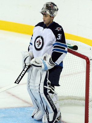 WINNIPEG, CANADA - SEPTEMBER 20: Ondrej Pavelec #31 of the Winnipeg Jets in net against the Columbus Blue Jackets at the MTS Centre on September 20, 2011 in Winnipeg, Manitoba, Canada. (Photo by Marianne Helm/Getty Images)