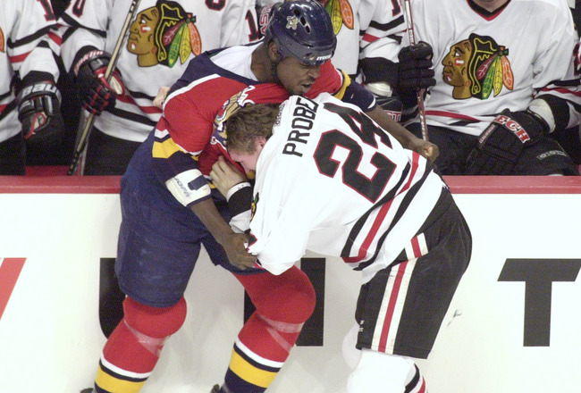 13 Feb 2002: Left wing Peter Worell #8 of the Florida Panthers fights with left wing Bob Probert #24 of the Chicago Blackhawks in front of the Blackhawks bench in NHL action at the United Center in Chicago, Illinois.  DIGITAL IMAGE Mandatory Credit: Jonat