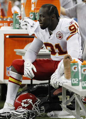 DETROIT, MI - SEPTEMBER 18:  Tamba Hali #91 of the Kansas City Chiefs watches the action from the bench after suffering a second half injury during the game against the Detroit Lions at Ford Field on September 18, 2011 in Detroit, Michigan. The Lions defe