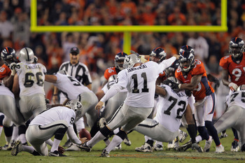 DENVER, CO - SEPTEMBER 12:  Place kicker Sebastian Janikowski #11 of the Oakland Raiders kicks a 63 yard field goal from the hold of  Shane Lechler #9 of the Oakland Raiders with five seconds remaining in the first half to give the Raiders a 16-3 lead ove