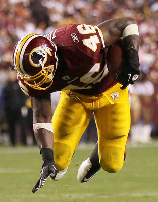 LANDOVER, MD - OCTOBER 17:  Ryan Torain #46 of the Washington Redskins goes airborn while eluding a tackler against the Indianapolis Colts at FedExField on October 17, 2010 in Landover, Maryland. The Colts won the game 27-24.  (Photo by Win McNamee/Getty