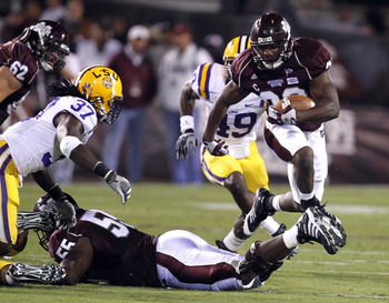 STARKVILLE, MS - SEPTEMBER 15:  Running back Vick Ballard #28 of the Mississippi State Bulldogs tries to hurdle offensive linesman Quentin Saulsberry #55 of the Mississippi State Bulldogs as linebacker Karnell Hatcher #37 of the LSU Tigers closes in for t