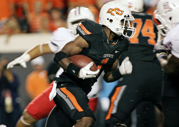 STILLWATER, OK - SEPTEMBER 8:  Running back Joseph Randle #1 of the Oklahoma State Cowboys rushes up field during the second half  past the Arizona Wildcats defense on September 8, 2011 at Boone Pickens Stadium in Stillwater, Oklahoma.  Oklahoma State def