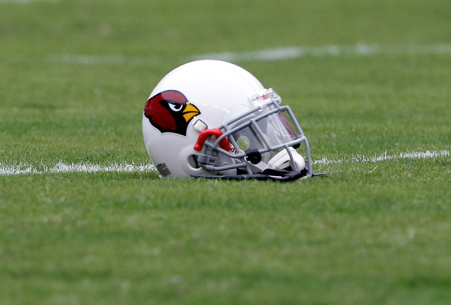 LANDOVER, MD - SEPTEMBER 18:  An Arizona Cardinals helmet sits on the field during warm ups prior to the start of the Cardinals and Washington Redskins game at FedExField on September 18, 2011 in Landover, Maryland.  (Photo by Rob Carr/Getty Images)