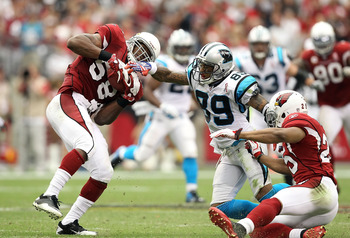 GLENDALE, AZ - SEPTEMBER 11:  Linebacker Daryl Washington #58 of the Arizona Cardinals runs with the football after an interception during the NFL season opening game against the Carolina Panthers at the University of Phoenix Stadium on September 11, 2011