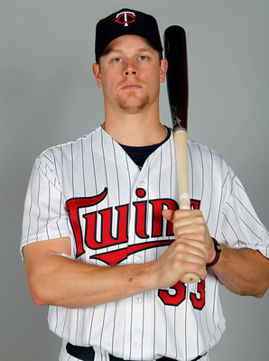 FORT MYERS, FL - FEBRUARY 25:  Infielder Justin Morneau #33 of the Minnesota Twins poses for a photo during photo day at Hammond Stadium on February 25, 2011 in Fort Myers, Florida.  (Photo by J. Meric/Getty Images)