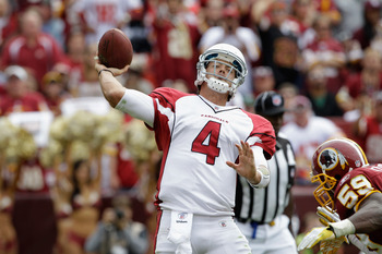 LANDOVER, MD - SEPTEMBER 18:  Quarterback  Kevin Kolb #4 of the Arizona Cardinals rolls out to pass while being pressured by defender  London Fletcher #59 of the Washington Redskins during the second half at FedExField on September 18, 2011 in Landover, M