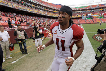 LANDOVER, MD - SEPTEMBER 18:  Wide receiver Larry Fitzgerald #11 of the Arizona Cardinals runs off the field following the Cardinals 22-21 loss to the Washington Redskins at FedExField on September 18, 2011 in Landover, Maryland.  (Photo by Rob Carr/Getty