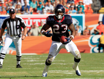 MIAMI GARDENS, FL - SEPTEMBER 18:   Arian Foster #23 of the Houston Texans rushes for yardage during a game against the Miami Dolphins at Sun Life Stadium on September 18, 2011 in Miami Gardens, Florida.  (Photo by Sam Greenwood/Getty Images)