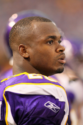 MINNEAPOLIS, MN - SEPTEMBER 18:    Adrian Peterson #28 of the Minnesota Vikings watches against the Tampa Bay Buccaneers at the Hubert H. Humphrey Metrodome on September 18, 2011 in Minneapolis, Minnesota.  (Photo by Adam Bettcher /Getty Images)