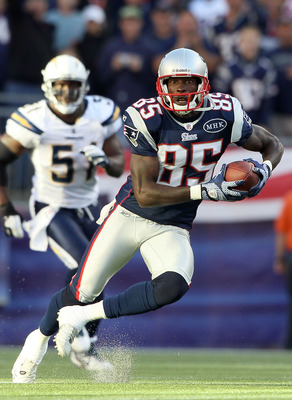 FOXBORO, MA - SEPTEMBER 18:  Chad Ochocinco #85 of the New England Patriots carries the ball in the second half against the San Diego Chargers on September 18, 2011 at Gillette Stadium in Foxboro, Massachusetts.  (Photo by Elsa/Getty Images)